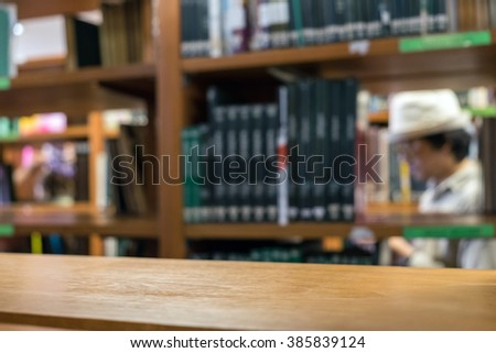 Shelves wood many book sort stacked on wooden shelf in library - stock photo