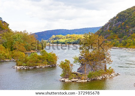 Shenandoah River and Potomac River meet each other near Harpers Ferry historic town. Old bridge bearings in the water in autumn, Harpers Ferry, West Virginia. - stock photo
