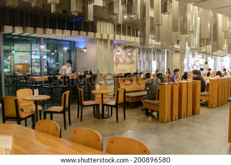 SHENZHEN, CHINA-APRIL 13: Starbucks Cafe interior on April 13, 2014 in Shenzhen, China. Starbucks Corporation is an American global coffee company and coffeehouse chain based in Seattle, Washington