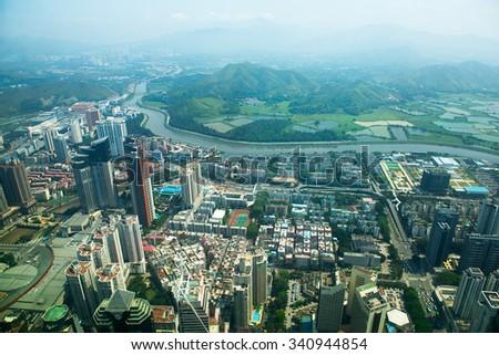 SHENZHEN, CHINA APRIL 23 2013: View of the border between Shenzhen and Hong Kong from the Diwang dahsa tower - stock photo