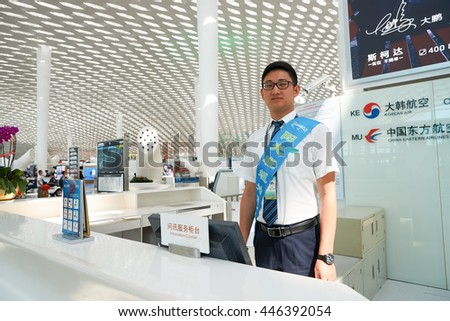 SHENZHEN, CHINA - CIRCA MAY, 2016: portrait of staff in Shenzhen Bao'an International Airport. It is located near Huangtian and Fuyong villages in Bao'an District, Shenzhen, Guangdong, China.
