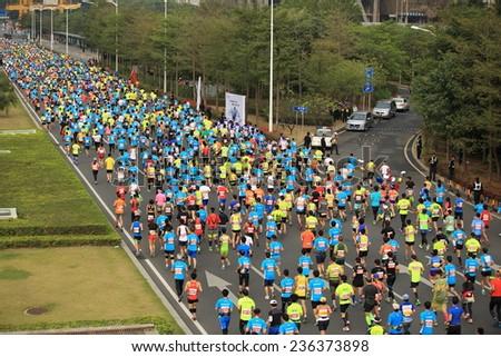 SHENZHEN,CHINA - DECEMBER 7: Unidentified marathon runners on the street at Shenzhen International Marathon DECEMBER 7, 2014 in Shenzhen, China  - stock photo