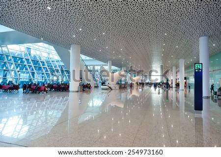 SHENZHEN, CHINA - FEBRUARY 16, 2015: airport interior. Shenzhen Bao'an International Airport is located near Huangtian and Fuyong villages in Bao'an District, Shenzhen, Guangdong - stock photo