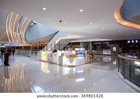 SHENZHEN, CHINA - JANUARY 24, 2016: interior of Shenzhen Vanke Plaza. Shenzhen Vanke Plaza Shopping mall is high-end complex located in the downtown area of Longgang district in ShenZhen - stock photo