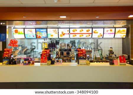 SHENZHEN, CHINA - MAY 25, 2015:  interior of McDonald's restaurant. McDonald's is the world's largest chain of hamburger fast food restaurants, founded in the United States. - stock photo