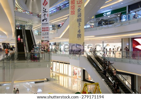 SHENZHEN, CHINA - MAY 17, 2015: shopping center interior. Shenzhen is a major city in the south of China, situated immediately north of Hong Kong Special Administrative Region.