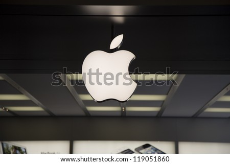 SHENZHEN, CHINA - NOV. 3: The Apple Macintosh symbol over the entrance of Apple store. Apple open its seventh Apple store in mainland China, located in SHENZHEN, November 3, 2012. - stock photo