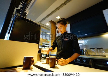 SHENZHEN, CHINA - OCTOBER 09, 2015: McCafe's barista preparing coffee. McCafe is a coffee house style food and drink chain, owned by McDonald's.
