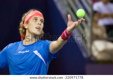 SHENZHEN, CHINA- SEPTEMBER 26, 2014: Lukas Lacko of Slovakia plays against Andy Murray of Great Britain in the quarter-final of ATP Shenzhen Open.