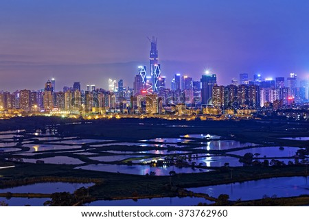 Shenzhen citscape at night , view from hiong kong countryside - stock photo