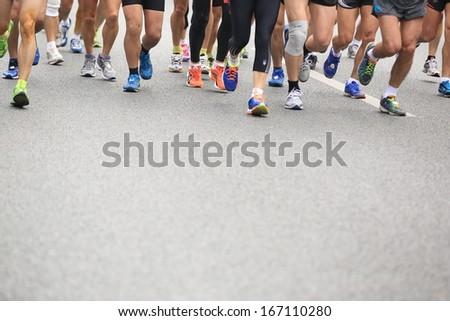 SHENZHEN - DEC 08: Unidentified athletes running at the shenzhen international marathon 2013, shennan road,shenzhen city,China,on DEC 08,2013 at Shenzhen city,Guangdong province,China.  - stock photo