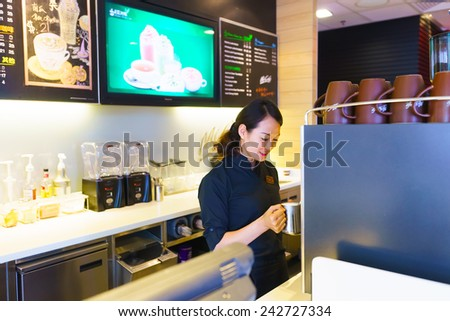 SHENZHEN - NOV 06: woman making coffee latte on November 06, 2014 in Shenzhen, China. The McDonald's Corporation is the world's largest chain of hamburger fast food restaurants - stock photo
