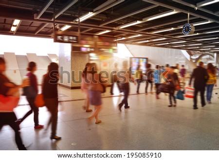 shenzhen Train Tube station Blur people movement in rush hour  - stock photo