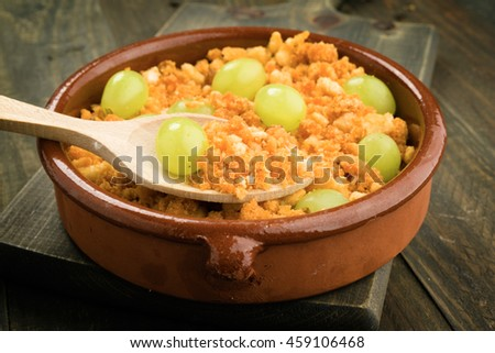 shepherd crumbs with wine and fresh grapes, aerial view of typical spanish food