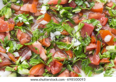 Shepherd salad mixed with minced onions tomatoes, peppers, cucumbers and seasoned with olive oil and lemon juice. Turkish Coban salata