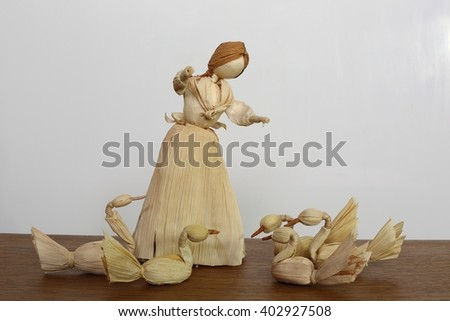 Shepherdess and geese (made from corn husks). Easter decoration. - stock photo