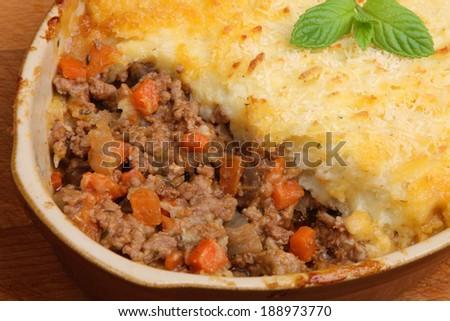 Shepherds pie in casserole dish - stock photo