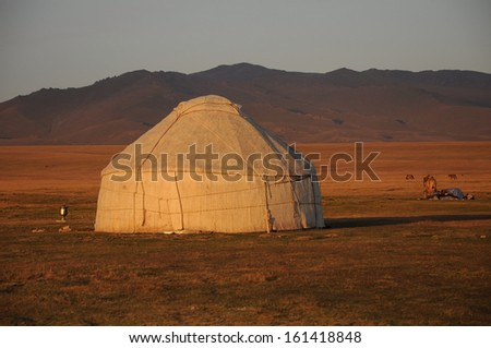 Shepherds tent Yurt, Kyrgyzstan mountain scenery - stock photo