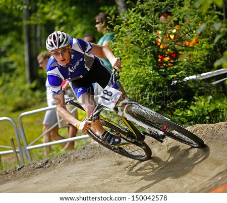 SHERBROOKE, CANADA - August 7: Isaac Niles competes in men's mountain biking at the Canada Games August 7, 2013 in Sherbrooke, Canada.