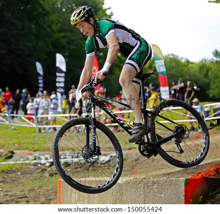 SHERBROOKE, CANADA - August 7: Jake Larsen competes in men's mountain biking at the Canada Games August 7, 2013 in Sherbrooke, Canada. - stock photo