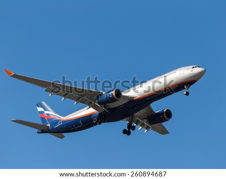 Sheremetyevo Airport -14 March 2015: Airbus A330 A. Bakoulev, Russian airline Aeroflot flies in the blue sky and puts the chassis 14 March 2015, Sheremetyevo Airport, Moscow Region, Russia