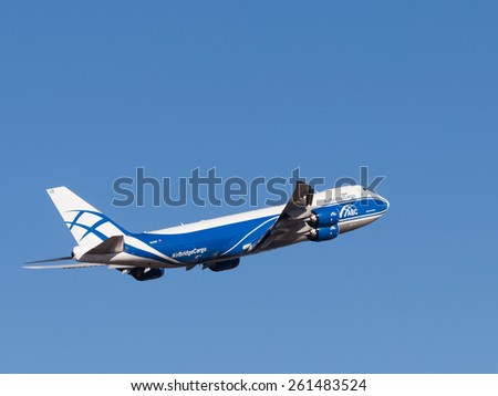 Sheremetyevo Airport -14 March 2015: Boing 747-8F aircraft, AirBridgeCargo Airlines takes off into the blue sky March 14, 2015, Sheremetyevo Airport, Moscow Region, Russia - stock photo
