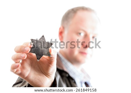 Sheriff presents his sheriff star badge isolated on white - stock photo