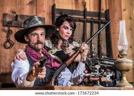 Sheriff Stands With Woman and a Loaded Gun - stock photo