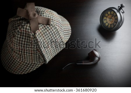 Sherlock Holmes Deerstalker Hat, Vintage Clock And Smoking Pipe On The Black Table Background. Overhead View.  Investigation Concept. - stock photo