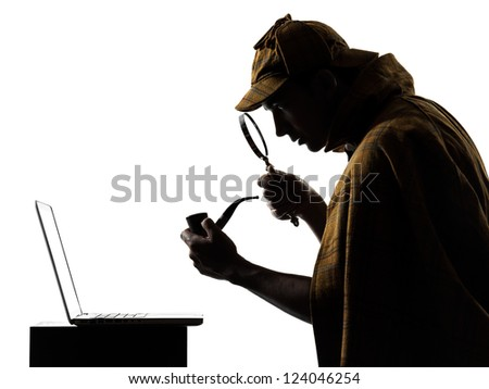 sherlock holmes silhouette in studio on white background - stock photo