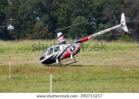 SHEVLINO, MOSCOW REGION, RUSSIA - JUNE 14, 2014: The championship of Russia on helicopter sports. Robinson R-44