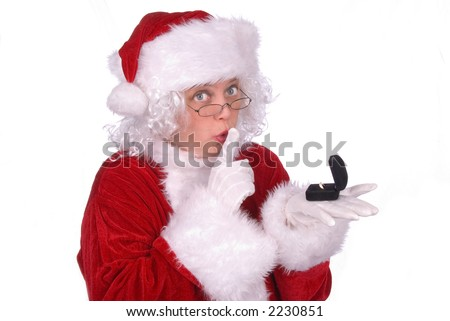 Shhhhhh, Mrs. Claus peeked at a ring under the Christmas tree