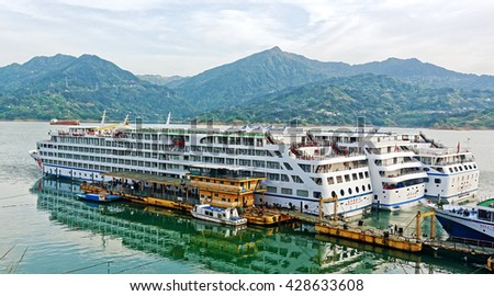 SHIBAOZHAI, CHINA â?? April 15, 2016: Three modern Chinese river cruisers on Yangtze River. Chinaâ??s cruise ship industry is expected to expand to 4.5 million passengers a year by 2020. - stock photo