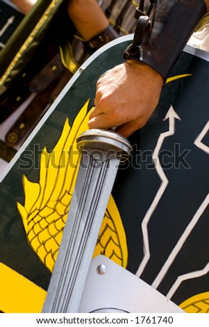 Shields and weapons of roman legionaries - stock photo