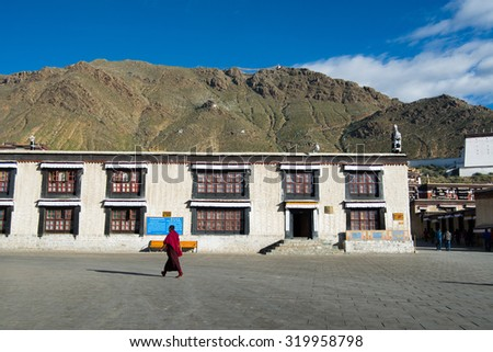 SHIGATSE, TIBET, CHINA-SEPTEMBER 16, 2015: Monks walk in Tashilhunpo monastery in Shigatse, Tibet.