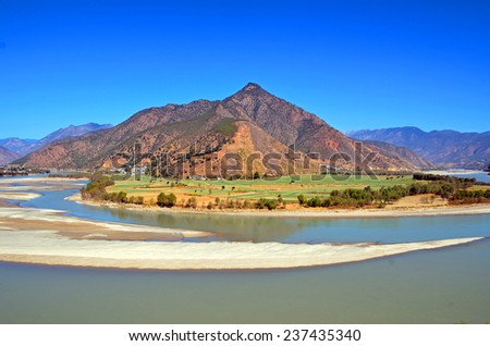 SHIGUZHEN, CHINA - NOVEMBER 27, 2014: First Bend of the Yangtze River is in Yunnan Province, where the river turns 180 degrees from south to north bound.  - stock photo