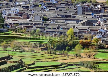 SHIGUZHEN, CHINA - NOVEMBER 27, 2014: Shiguzhen is a town in Yunnan Province and about 2000 meters above sea level. Naxi ethnic minority live in this town. - stock photo