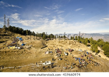 Shilma,India, Dec 24th, 2015 : The crowd of tourist enjoyng the beautiful place in shimla , called Kufri Valley. Only way to reach there is by horse ride. - stock photo