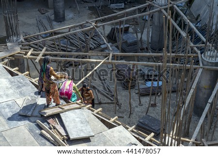 SHIMLA, INDIA - Jun 04, 2016: Group of Indian women workers at the construction site.