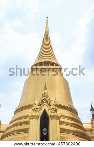 Shimmering Golden Stupa at Wat Phra Kaew in the Grand Palace Complex in Bangkok, Thailand - stock photo
