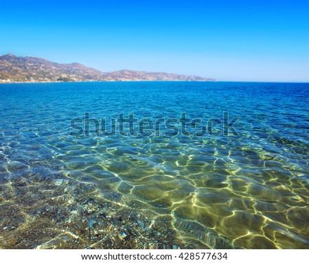 Shining blue water ripple background - stock photo