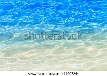 Shining blue water ripple background. Clear sea water background. Photo from Kalamitsi, Sitonia, Halkidiki, Macedonia, Northern Greece. - stock photo
