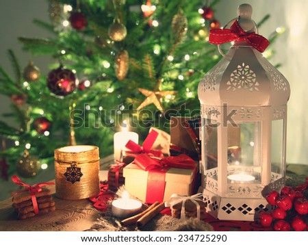 shining candles with christmas decorations