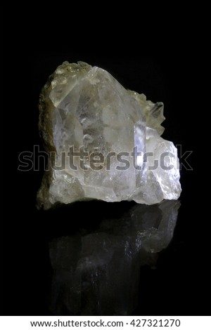 Shining crystal with reflections on black background - stock photo