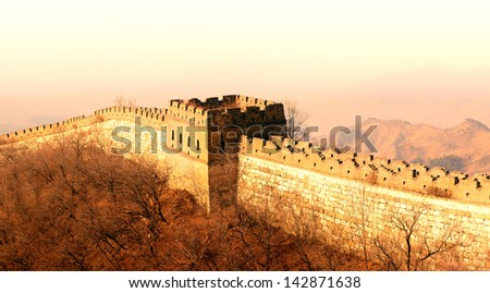 Shining Great Wall sunset over mountains in Beijing, China. - stock photo