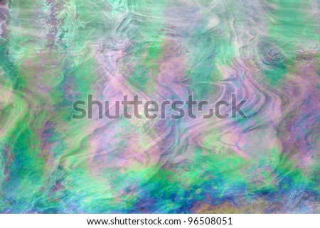 Shining mother of pearl texture with wave patterns - stock photo
