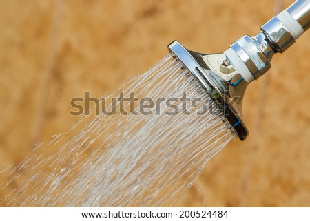 Shining stainless head shower while running water, outdoor at fitness. - stock photo