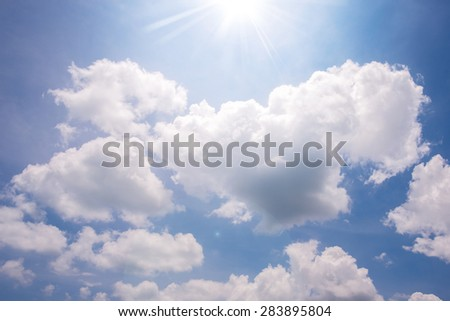 Shining sun and blue sky with cloud - stock photo