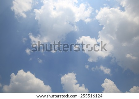 Shining sun at blue sky with white cloud and copy space  - stock photo