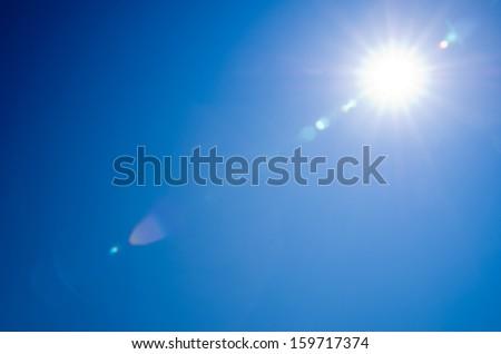 Shining sun at clear blue sky - stock photo